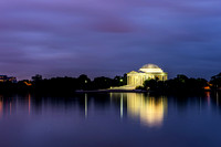 The Jefferson Memorial glows and reflects in the Tidal Basin in Washington DC