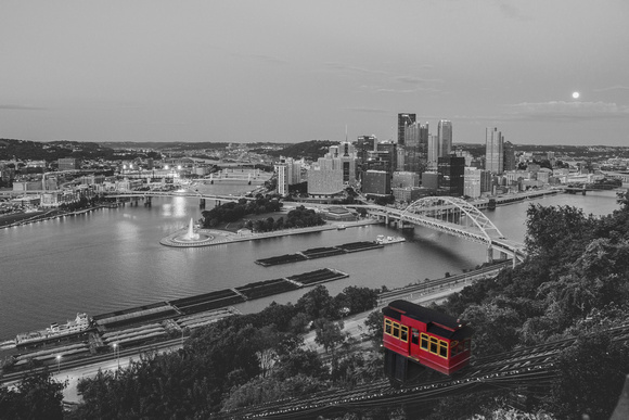 A ride car on the Duquesne Incline rises up Mt. Washington under the supermoon
