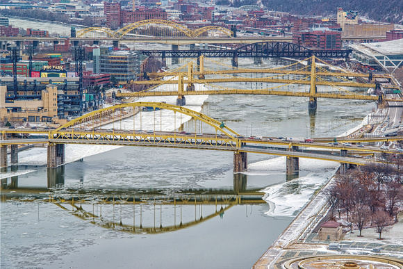Bridges cross a snow covered Allegheny River in Pittsburgh