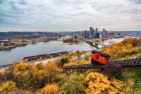 An incline makes its up Mt. Washington through the fall foliage in Pittsburgh