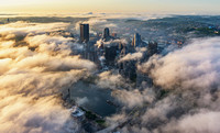 The sun illuminates the fog over Pittsburgh at dawn