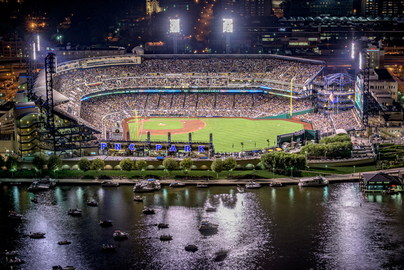 A view of PNC Park in Pittsburgh from a rooftop at night