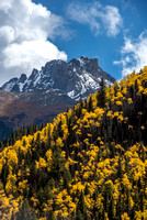 Mountains rise over fall colors in Colorado