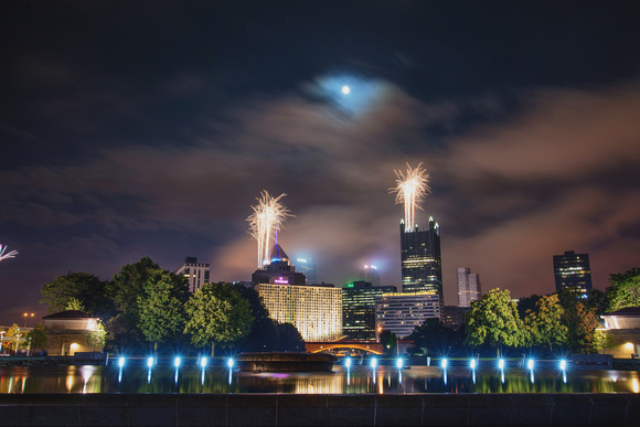 Fireworks and the moon over downtown Pittsburgh from Point State Park
