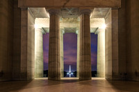 Pillars from the Lincoln Memorial frame the Washington Monument