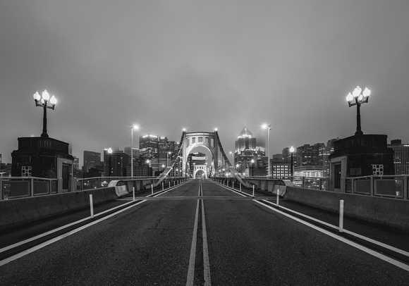 A black and white foggy morning on the Clemente Bridge